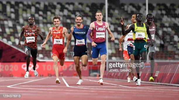Australia's Peter Bol celebrates as he crosses the finish line in first place next to second-placed USA's Clayton Murphy , third-placed France's...