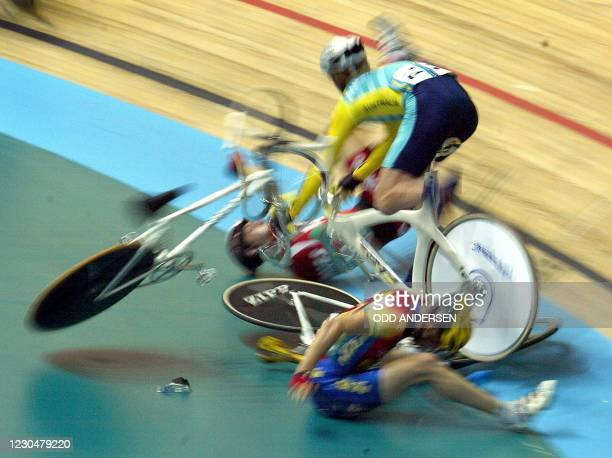 Australia's Peter Dawson ploughs into Welsh rider Will Wright and Mark Kelly from Isle of Man during the men's point race final at the X V II...