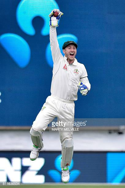 Australia's Peter Nevill celebrates catching Tom Latham of New Zealand during day three of the second cricket Test match between New Zealand and...