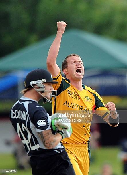 Australia's Peter Siddle celebrates the wicket of NewZealand's captain Brendon McCullum during the ICC Champions Trophy's final match between...