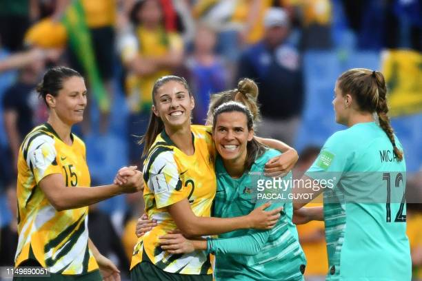 Australia's players celebrate after winning the France 2019 Women's World Cup Group C football match between Australia and Brazil on June 13 at the...