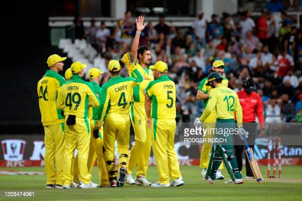 Australia's players celebrate taking the wicket of South Africa's Quinton de Kock during the third and final T20 international cricket match between...