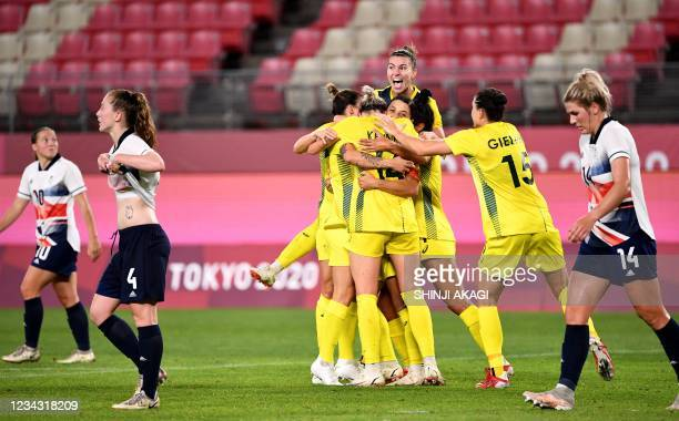 Australia's players celebrate their goal during the Tokyo 2020 Olympic Games women's quarter-final football match between Britain and Australia at...