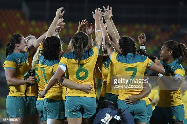 Australia's players celebrate victory in the womens rugby sevens gold medal match between New Zealand and Australia during the Rio 2016 Olympic Games...