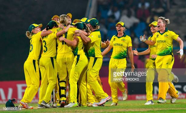 Australia'S players celebrate winning the ICC Women's World T20 final cricket match between Australia and England at Sir Vivian Richards Cricket...