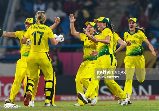 Australia's players celebrate winning the ICC Women's World T20 final cricket match between Australia and England at Sir Vivian Richards Cricket...