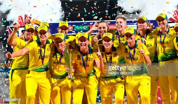 Australia's players celebrate winning the ICC Women's World T20 final cricket match against England at Sir Vivian Richards Cricket Ground North Sound...