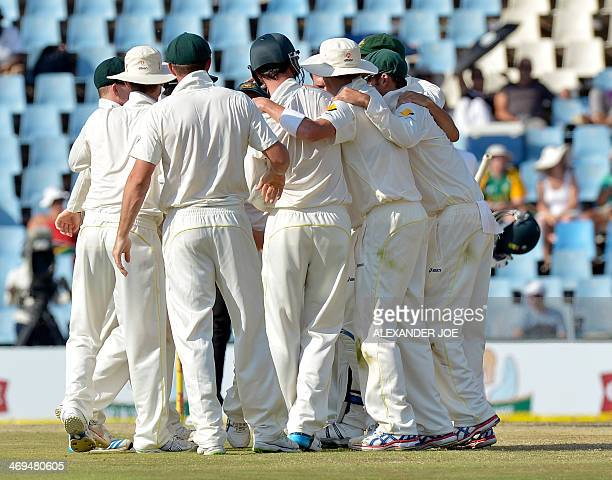 Australia's players celebrate winning the Test match by 281 runs after running out South Africa's cricketer Morne Morkel during the 4th day of the...