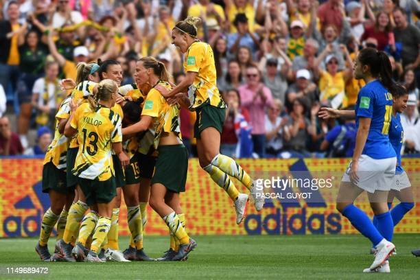 TOPSHOT Australia's players celebrates after scoring a second goal during the France 2019 Women's World Cup Group C football match between Australia...