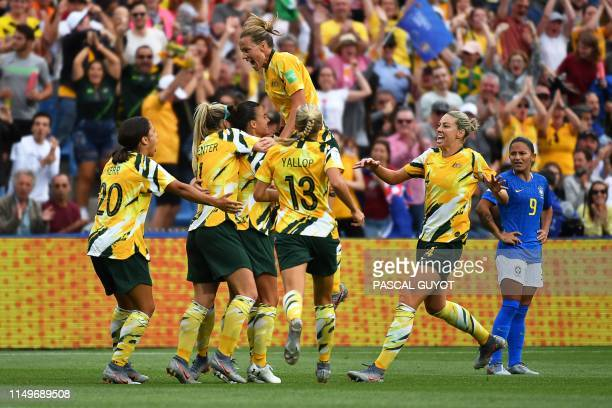 Australia's players celebrates after scoring a second goal during the France 2019 Women's World Cup Group C football match between Australia and...