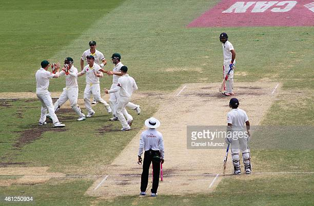 Australia's players mistakenly celebrate the wicket of Karn Sharma of India during day five of the Fourth Test match between Australia and India at...