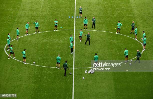 Australia's players take part in a training session of Australia national football team at the Kazan Arena in Kazan on June 15 on the eve of their...