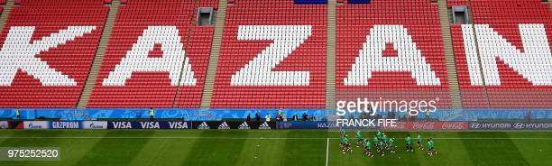 Australia's players take part in a training session of Australia national football team at the Kazan Arena, in Kazan, on June 15 on the eve of their...
