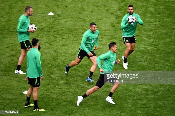 Australia's players warm up as they take part in a training session of Australia national football team at the Kazan Arena, in Kazan, on June 15 on...