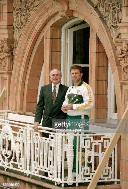 Australia's Prime Minister John Howard and Australia's team captain Mark Taylor standing on the dressing room balcony during the 2nd Test match...