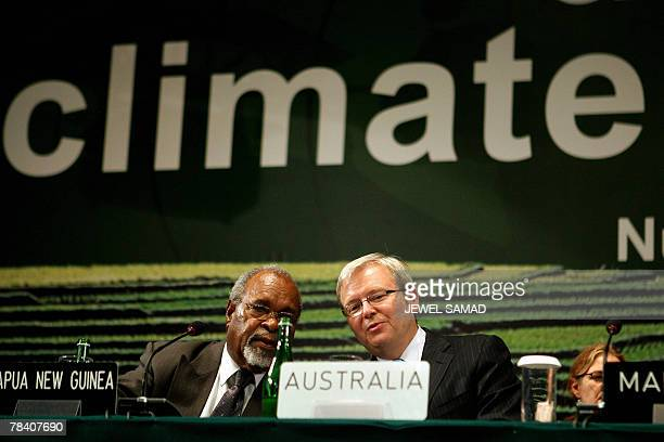 Australia's Prime Minister Kevin Rudd listens to his Papua New Guinea counterpart Michael Somare the start of the Third Session of Conference of...