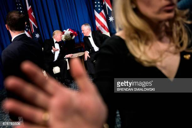 TOPSHOT Australia's Prime Minister Malcolm Turnbull confers with US President Donald Trump on board the Intrepid Sea Air and Space Museum May 4 2017...