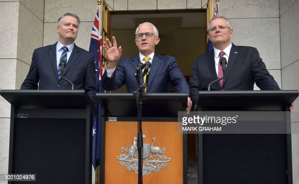 Australia's Prime Minister Malcolm Turnbull gestures as he speaks at a press conference beside Finance Minister Mathias Cormann and Treasurer Scott...