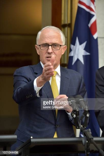 Australia's Prime Minister Malcolm Turnbull gestures at a press conference in Parliament House in Canberra on August 22 2018 The embattled leader...