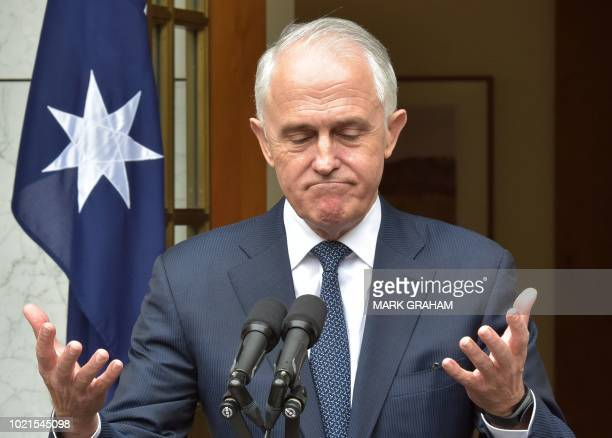 Australia's Prime Minister Malcolm Turnbull gestures during a press conference at Parliament House in Canberra on August 23 2018 Australian Prime...