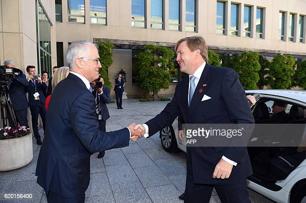 Australia's Prime Minister Malcolm Turnbull greets Dutch King WillemAlexander at Parliament House in Canberra on November 2 2016 The Dutch royals are...
