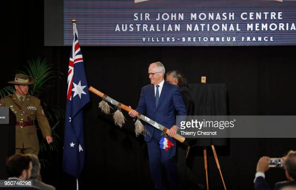 Australia's Prime Minister Malcolm Turnbull holds a Didgeridoo after the opening of the Sir John Monash Centre at Australian National Memorial on...