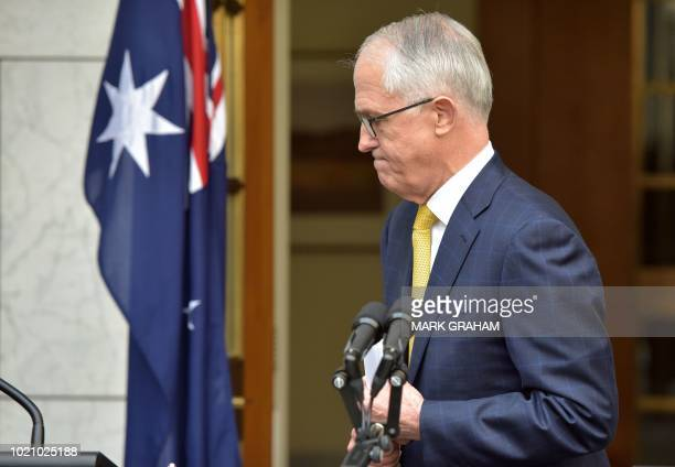 Australia's Prime Minister Malcolm Turnbull leaves a press conference in Parliament House in Canberra on August 22 2018 The embattled leader narrowly...