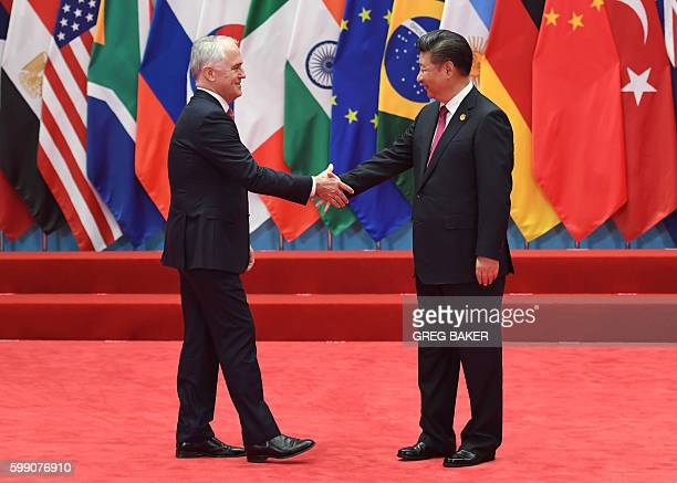 Australia's Prime Minister Malcolm Turnbull shakes hands with China's President Xi Jinping before the G20 leaders' family photo in Hangzhou on...