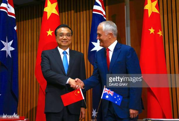 Australia's Prime Minister Malcolm Turnbull shakes hands with Chinese Premier Li Keqiang at the beginning of an official signing ceremony at...