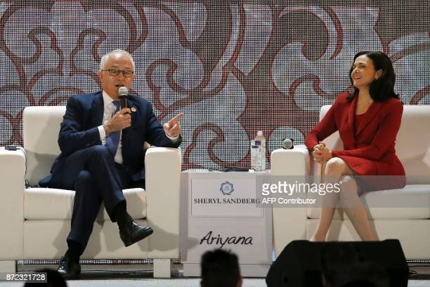 Australia's Prime Minister Malcolm Turnbull speaks as Sheryl Sandberg COO of Facebook looks on at a dialogue on the final day of the APEC CEO Summit...