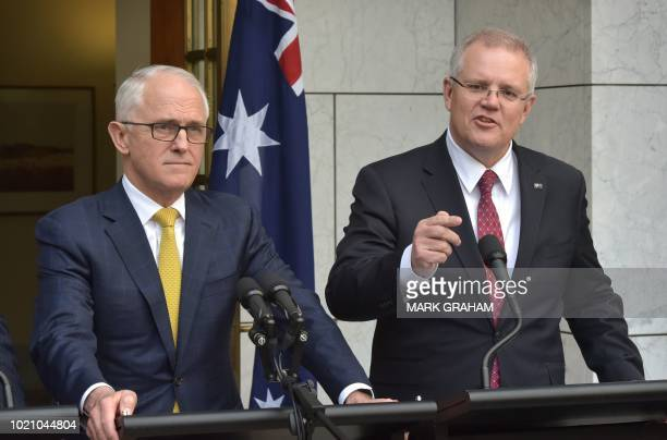 Australia's Prime Minister Malcolm Turnbull stands beside Treasurer Scott Morrison at a press conference in Parliament House in Canberra on August 22...