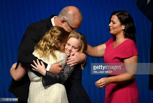 Australia's Prime Minister Scott Morrison hugs his daughters Abbey and Lily with wife Jenny Morrison after the Liberal Party's campaign launch in...