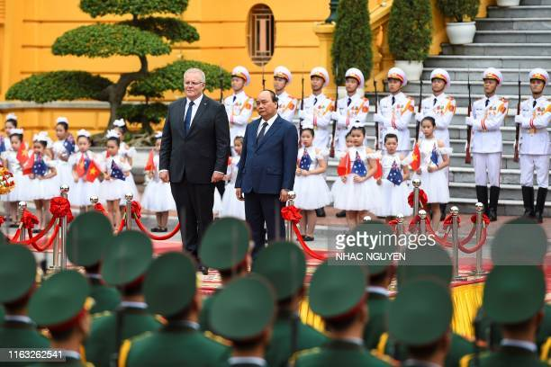 Australia's Prime Minister Scott Morrison inspects a guard of honour with his Vietnamese counterpart Nguyen Xuan Phuc during a welcoming ceremony at...
