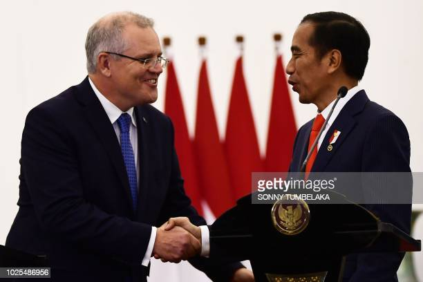 Australia's Prime Minister Scott Morrison shakes hands with Indonesia's President Joko Widodo during the welcoming ceremony at the presidential...
