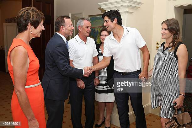 Australia's Prime Minister Tony Abbott along with his wife Margie Abbott receives England's cricketer Alastair Cook and his partner at a New Year's...
