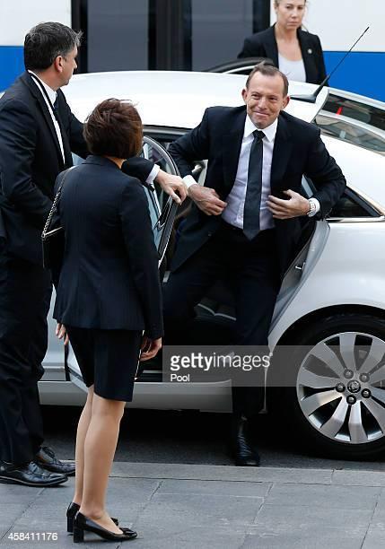 Australia's Prime Minister Tony Abbott arrives at the state memorial service for former Australian Prime Minister Gough Whitlam at Sydney Town Hall...