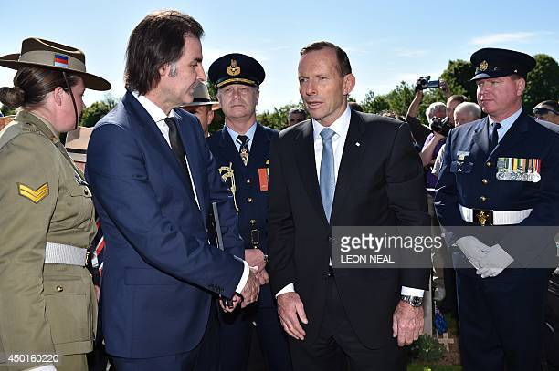 Australia's Prime Minister Tony Abbott arrives to attend a binational FranceUK DDay commemoration ceremony at the British War Cemetery of Bayeux on...