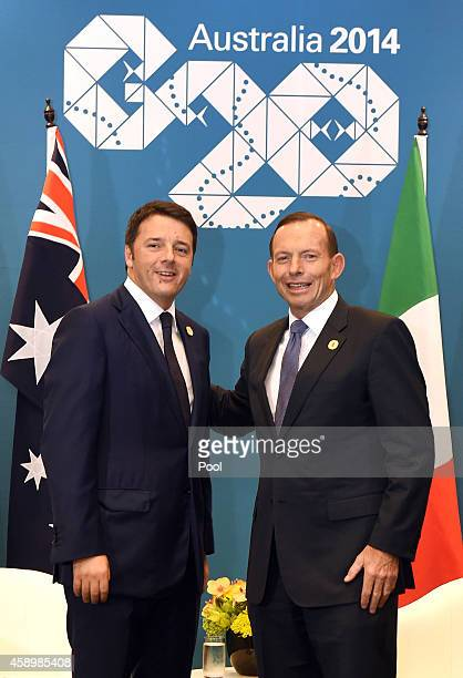 Australia's Prime Minister Tony Abbott greets Italy's Prime Minister Matteo Renzi during a bilateral meeting at the G20 Leaders' Summit on November...