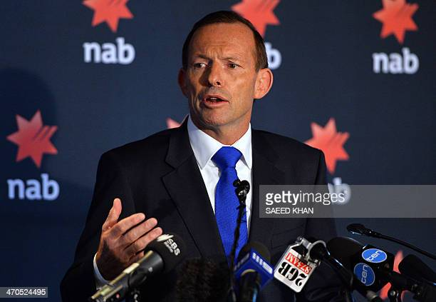 Australia's Prime Minister Tony Abbott speaks at the National Australia Bank's 2014 Reconciliation Action Plan launch in Sydney on February 20 2014...