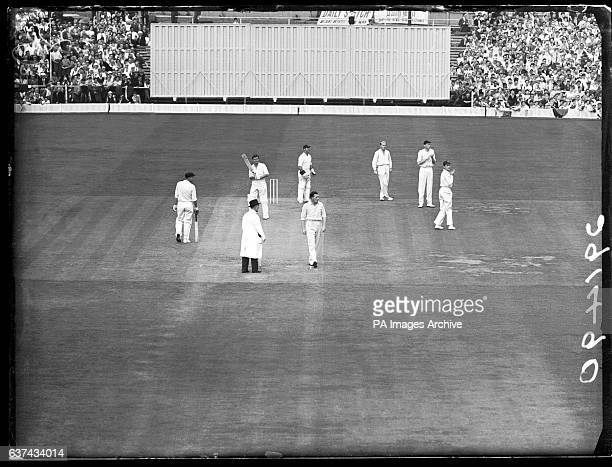 Australia's Richie Benaud is dismissed caught by England's Brian Statham off the bowling of Jim Laker