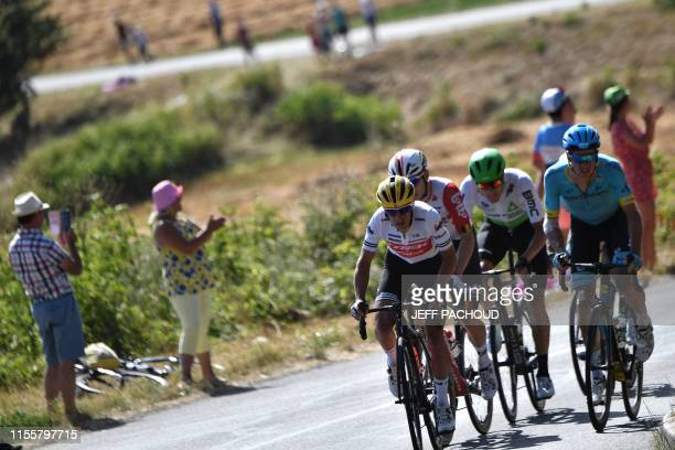 Australia's Richie Porte and cyclists ride in a group in the back of the race during the tenth stage of the 106th edition of the Tour de France...
