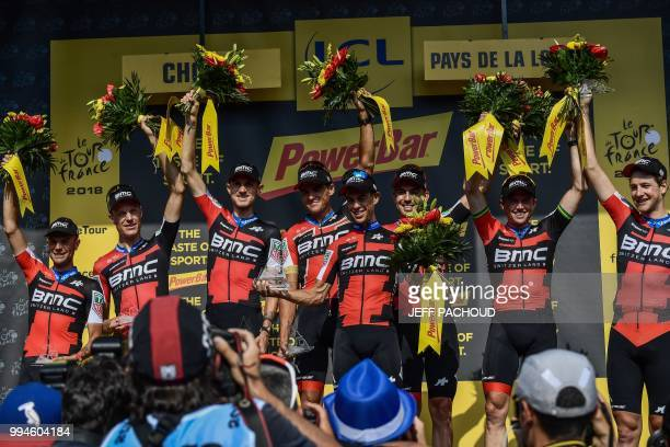 Australia's Richie Porte and his teammates of USA's BMC Racing cycling team celebrate on the podium after winning the third stage of the 105th...