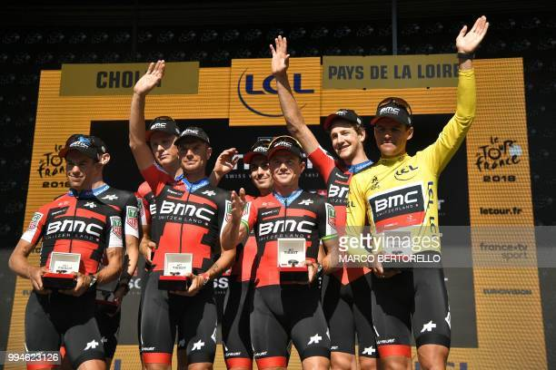 Australia's Richie Porte Belgium's Greg Van Avermaet wearing the overall leader's yellow jersey and their teammates of USA's BMC Racing cycling team...