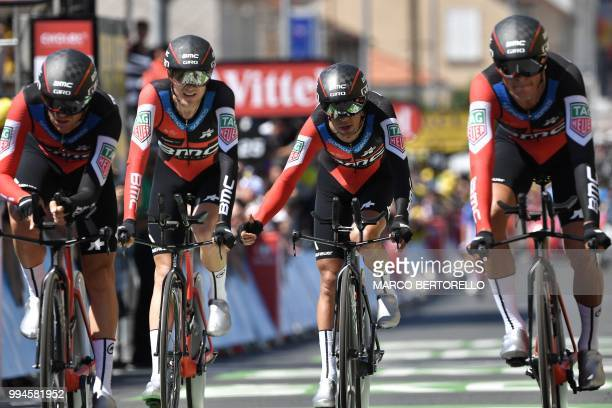 Australia's Richie Porte gestures as riders of USA's BMC Racing cycling team cross the finish line of the third stage of the 105th edition of the...