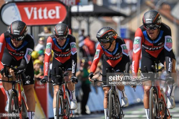 Australia's Richie Porte reacts as riders of USA's BMC Racing cycling team cross the finish line of the third stage of the 105th edition of the Tour...