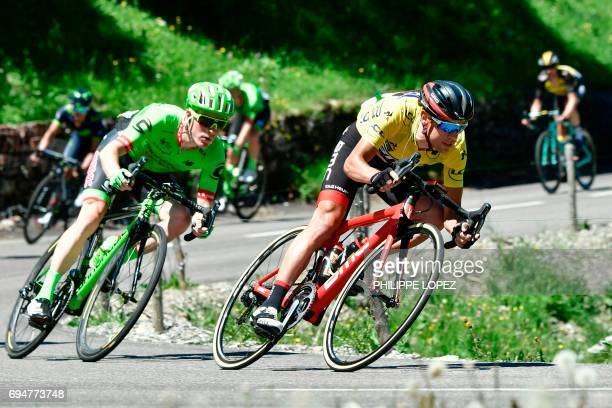 Australia's Richie Porte wearing the overall leader's yellow jersey rides ahead of USA's Andrew Talansky during the 115 km eighth stage of the 69th...