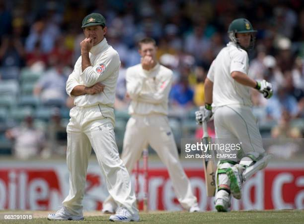 Australia's Ricky Ponting and Michael Clarke look on as South Africa's AB DeVilliers add more runs towards his century