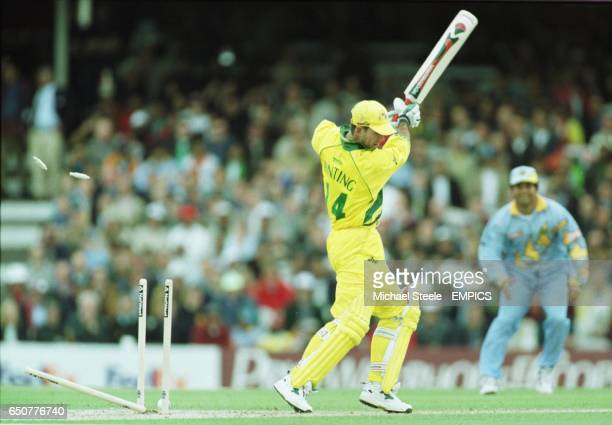 Australia's Ricky Ponting is clean bowled by India's Robin Singh