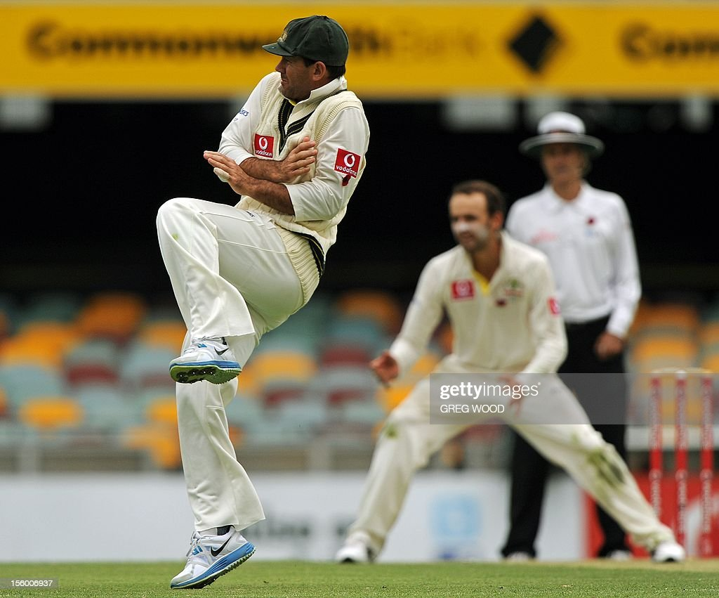 Australia's Ricky Ponting (L) takes evasive action as the ball is hit past him as he fields close to the bat on day three of the first cricket Test between South Africa and Australia at the Gabba ground in Brisbane on November 11, 2012. IMAGE STRICTLY RESTRICTED TO EDITORIAL USE - STRICTLY NO COMMERCIAL USE AFP PHOTO / Greg WOOD
