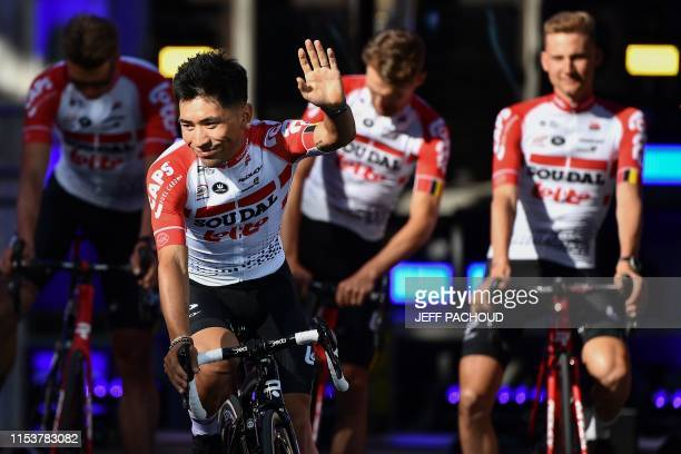Australia's rider Caleb Ewan of Belgium's LottoSoudal and teammates leave the team presentation ceremony at the GrandPlace Grote Markt Square in...